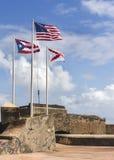 Three flags on top of Castillo San Felipe del Morro. Stock Images