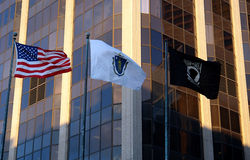 Three Flags United States Massachusetts POW MIA. Three flags blowing in the breeze on a windy autumn afternoon Royalty Free Stock Photo