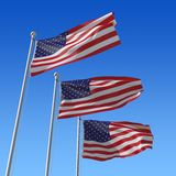 Three flags of USA against blue sky. Royalty Free Stock Photos