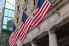 Three flags. Wavering on the side of a concrete buidling Stock Images
