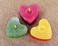 Three flaming candles. Stock Photo
