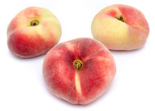 Three flat peaches Royalty Free Stock Photo