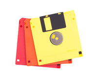 Three floppy disk. Three floppy disk of different color on a white background Royalty Free Stock Photos