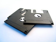 Three floppy disks. 3, 3 1/2 inch floppy disks on white surface with blue light Stock Photo