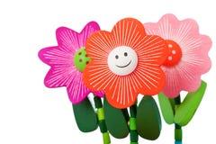 Three Floppy Wooden Flower Toys Stock Photos