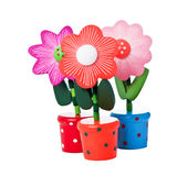 Three Floppy Wooden Flower Toys Royalty Free Stock Image