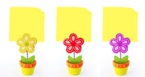Three flower note holders with empty yellow notes Stock Images