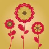 Three Flowers. Bright stitched flowers on yellow-orange background Stock Photos