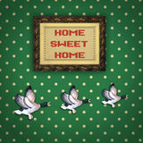 Three flying ducks with Picture frame. Vintage three flying ducks on old wallpaper with a Picture frame saying home sweet home Stock Images