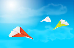 Three flying paper planes, sky, clouds and sun Stock Photo