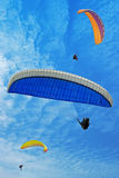 Three flying parachutes Stock Photos