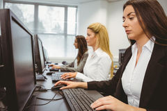 Three focused women working in computer room Royalty Free Stock Photo