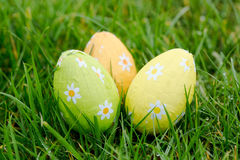 Three easter eggs in the grass Stock Images