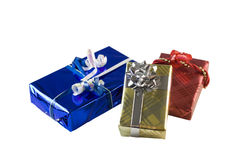 Three foil wrapped presents Stock Image