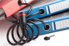 Three folders  linked  together with bicycle lock Royalty Free Stock Photos