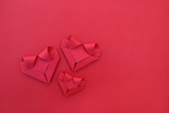Three Folding Red Paper Hearts On Red For Pattern And Background Stock Image