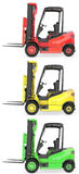 Three fork lift trucks colored as traffic lights Stock Photography