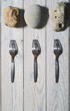 Three forks and three stones Stock Photo