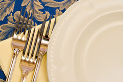 Three forks and white china plate Stock Photos