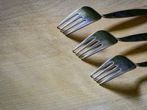 Three forks on a wooden board Royalty Free Stock Image