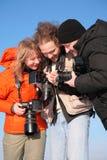 Three fotographers Stock Photo
