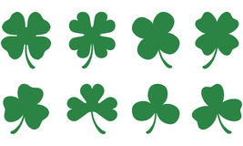 Three and Four Leaf Clovers. Silhouettes of different four and three leaf clovers / shamrocks Stock Images