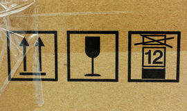 Three fragile symbol on cardboard Royalty Free Stock Photo