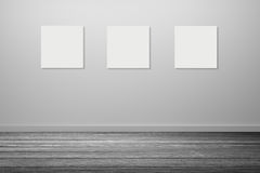 three frame of white poster hanging in empty room.space for your text and picture.product display template.Business presentation. Stock Photos