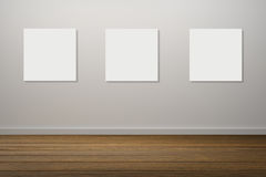 Three frame of white poster hanging in empty room.space for your text and picture.product display template.Business presentation. Royalty Free Stock Images