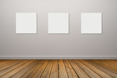 Three frame of white poster hanging in empty room.space for your text and picture.product display template.Business presentation. Stock Photo