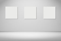 Three frame of white poster hanging in empty room.space for your text and picture.product display template.Business presentation. Royalty Free Stock Photos