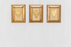 Three framed gold hearts. White background. Copy space. Stock Photography