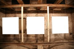 Three frames. White frames among brick walls Stock Photo