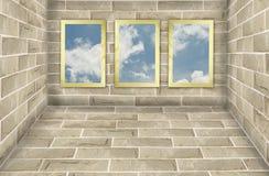 Three frames on brick wall Stock Photo