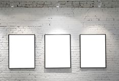 Three frames on brick wall Royalty Free Stock Photos