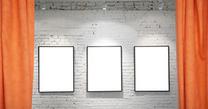 Three frames on brick wall and draperies collage stock photography