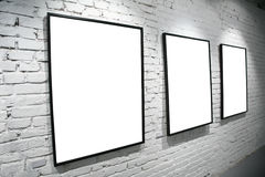 Three frames on brick white wall stock image