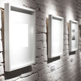Three frames on white wall Royalty Free Stock Photos