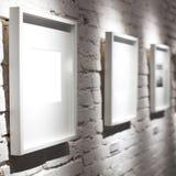 Three frames on white wall Royalty Free Stock Photos