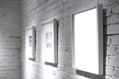 Three frames on white wall royalty free stock image