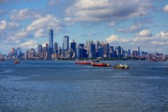Three freighters and New York City Stock Photos