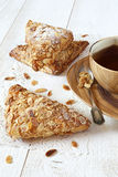Three French puff with ground almonds and a cup of black tea Stock Images