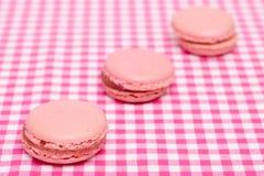 Three french strawberry macarons Stock Photo