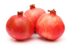 Three fresh appetizing pomegranates Royalty Free Stock Photography