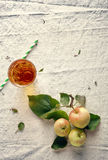 Three Fresh Apples and Glass on Off White Stock Photo