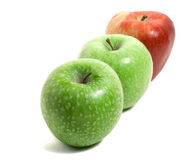 Three fresh apples in a row Stock Photo