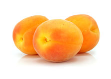 Three fresh apricot fruits  isolated Royalty Free Stock Image