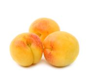 Three fresh apricot fruits isolated Stock Photos