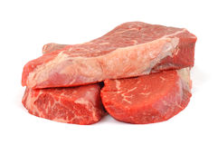 Three fresh beef chuck shoulder steaks Stock Photos