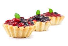 Three fresh blackberry and raspberry cakes Stock Photos